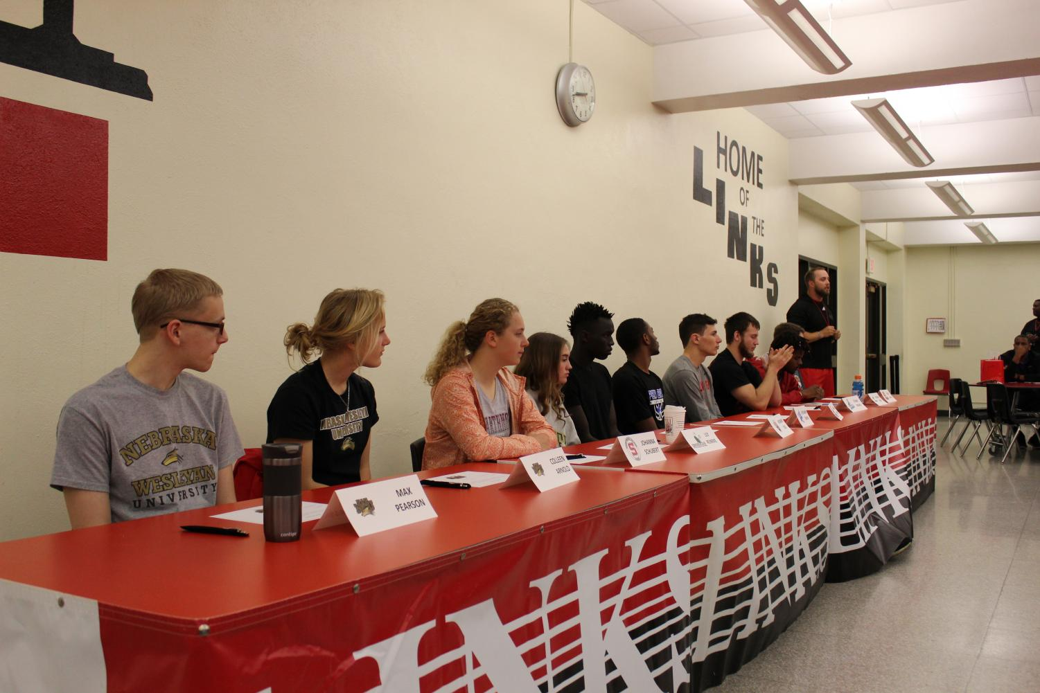 Students, staff, and families gather in the LHS cafeteria on Tuesday, May 7th, 2019, for Spring Signing Day. Ten student-athletes (Max Pearson, Colleen Arnold, Johanna Schubert, Lily Reinke, Boomer Jock, Keyshawn Jenkins, Graham Newton, Ethan Bruha, Morgan Perry, and Dylan McNeil) signed letters of intent to participate in athletics at the colleges and universities of their choice.  Photo by Zeke Williams