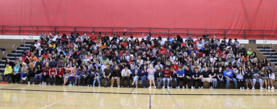 Seniors sit on their phones waiting for the senior picture on May 2, 2019. Photo courtesy of The Advocate.