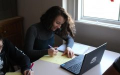 Nina Friedman (10), works on homework in her spanish class. Photo by Nina Friedman.
