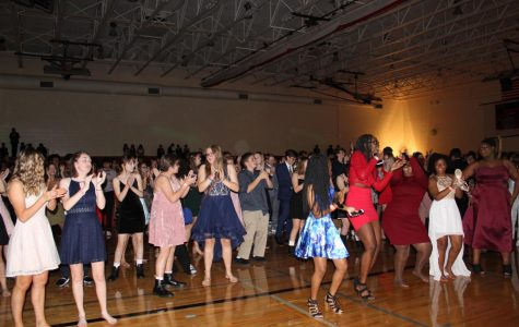 Students dance along to the Cha-Cha Slide at the Homecoming Dance on Friday, October 11, 2019. Photo by Kianna Gibson