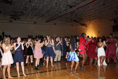Students dance the night away after homecoming football victory