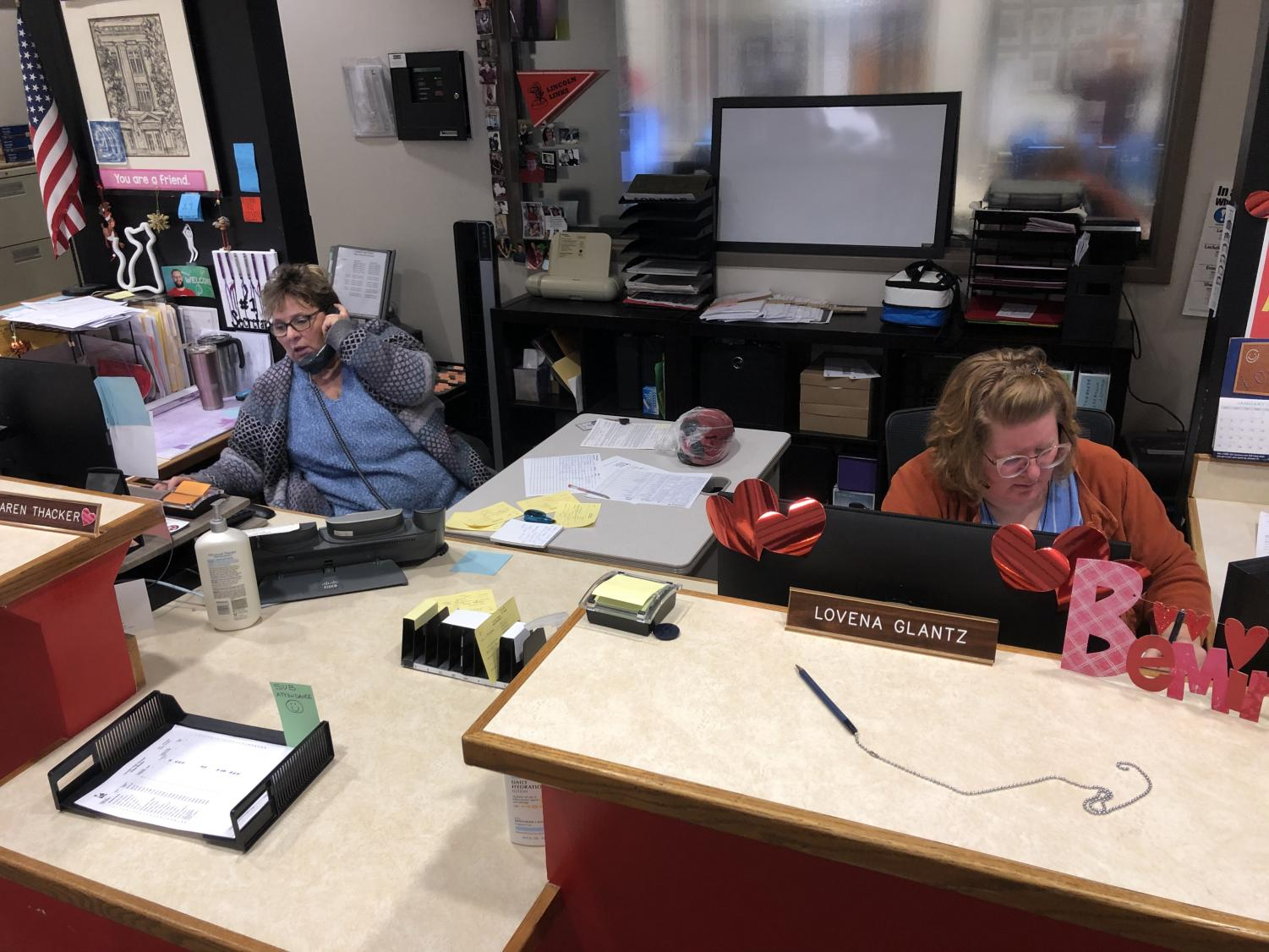 Attendance Office Secretaries Karen Thacker (left) and Lovena Glantz (right) take phone calls Wednesday morning, January 22, 2020, from parents excusing students due to weather conditions. Attendance was down significantly after an early-morning snow storm made street conditions hazardous.