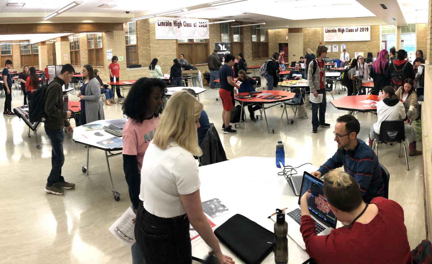Students and parents gather in the cafeteria on Wednesday, Jan. 8, 2020 to learn about the variety of after school opportunities offered by the Lincoln High School Community Learning Center.
