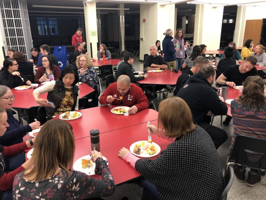 Teachers and staff fuel up for a work day with breakfast provided by the administration in the cafeteria on Monday, Jan. 6, 2020. Staff members returned to school a day before the start of the new semester.