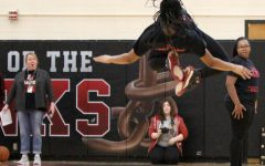 Airborne! Star Grandberry (11) stuns the crowd (and Ms. Swartz) with an amazing back flip during IIG's performance at the Winter Pep Rally on February 24, 2020. Photo by Greg Keller