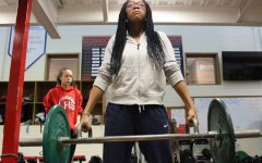 Serenity Williams (9) does Hex bar shoulder shrugs in Mark Macke's 6th period weight training class. Photo by Brittyn Schutz