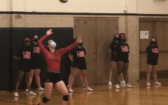 LHS JV volleyball player serves against Millard West.