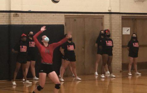LHS JV volleyball player serves against Millard West.