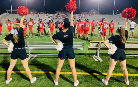LHS Cheerleaders cheer on the links