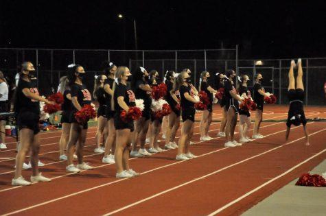 Cheerleaders showing spirit during game.